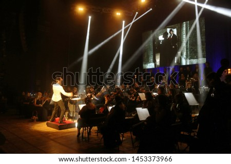 ODESSA, UKRAINE - July 16, 2019: A concert by the symphony orchestra of Andrey Cherny on the theater stage of the Odeskogot Opera Theater. Symphony orchestra musicians perform OSCAR cinematic hits #1453373966