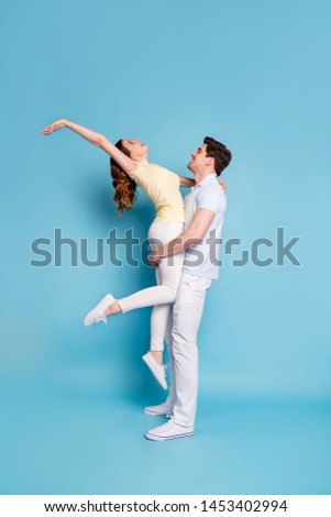 Vertical full length body size profile side view of nice attractive cheerful cheery spouses wearing casual having fun free spare time isolated over bright vivid shine blue green background #1453402994