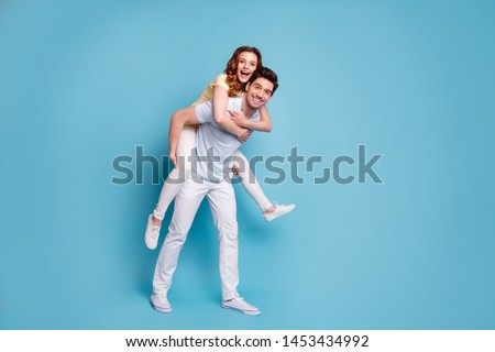Full length body size view of his he her she nice-looking attractive cheerful cheery positive married spouses wearing casual having fun fooling isolated over bright vivid shine blue green background #1453434992