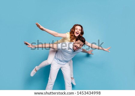 Portrait of his he her she nice-looking attractive cheerful cheery childish funky playful people wearing casual having fun isolated over bright vivid shine blue green background #1453434998