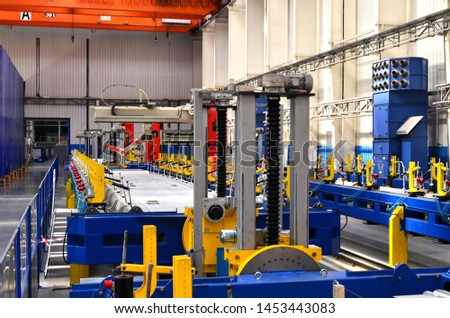 Robotic welding complex in the production workshop factory for the  manufacturing of modern rail transport and locomotives. Weld seam tracker, robotersysteme. Cutting, measuring and welding technology #1453443083