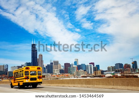 School bus on road over Chicago city Illinois, USA