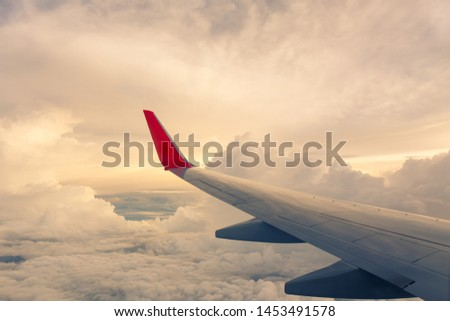 Morning sunrise with Wing of an airplane. Photo applied to tourism operators and fast and efficient transportation. picture for add text message or art work frame website. Traveling concept.