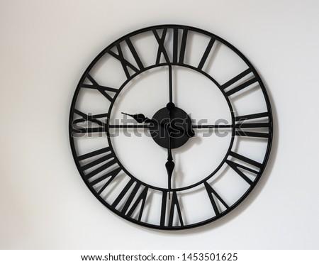 Wall clock on a white background. Twenty one hour thirty minutes. Half past nine. Nine-thirty. 9-30 , 21-30 . #1453501625