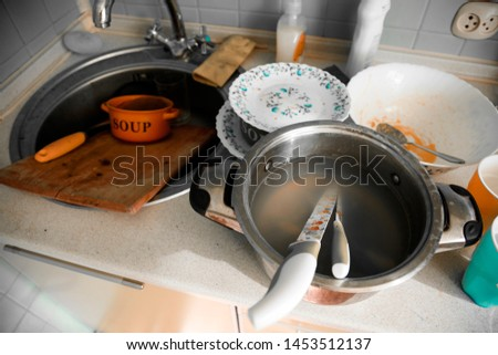 Dirty dirty dishes, glasses, forks, pan in the kitchen #1453512137