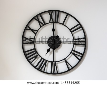 Wall clock on a white background. Seven o'clock in the morning . Nineteen hours. 7-00 . 19-00. #1453514255