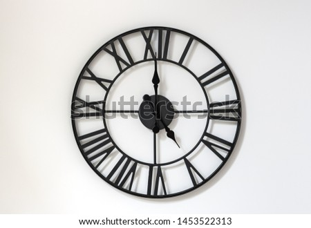 Wall clock on a white background. Five o'clock. Seventeen hours. 5-00 . 17-00. #1453522313