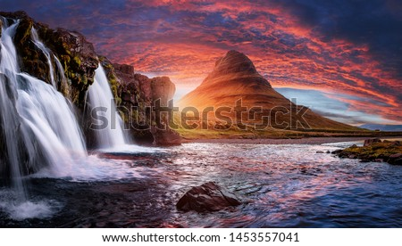 Scenic image of Iceland. Incredible Nature scenery during sunset. Great view on famous Mount Kirkjufell with Colorful, dramatic sky. popular plase for photografers. Best famous travel locations.
