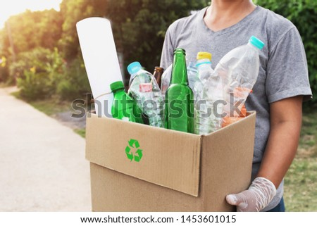 woman hand holdging box garbage for recycle #1453601015