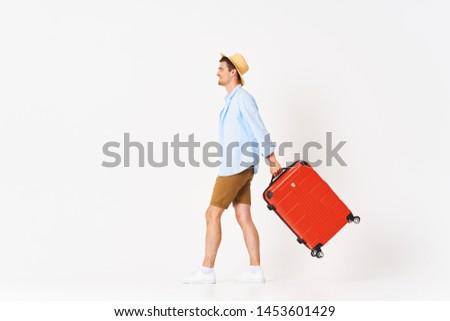 Handsome man beachwear red suitcase self-confidence joy lifestyle #1453601429