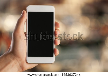 Smartphone frameless in hand blank screen isolated on white background - Image