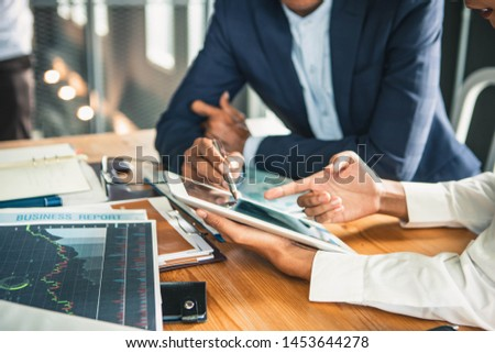 Brainstorming Group of people Working Concept. Business team brainstorming. Marketing plan researching. Paperwork on the table, laptop and mobile phone. #1453644278