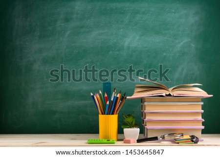 Education and reading concept - group of colorful books on the wooden table