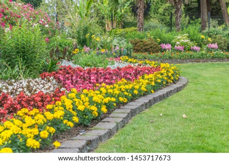 A view of a lawn and flower garden at Point Defiance Park in Tacoma, Washington. #1453717673