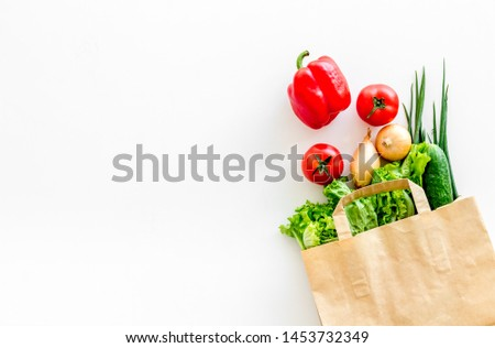 Buying fresh vegetables in paper bag on white background top view copyspace #1453732349