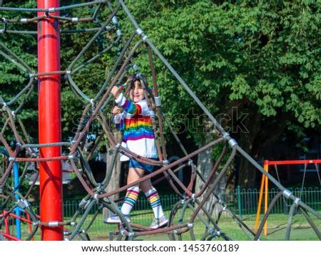 kid girl doing rock climbing #1453760189