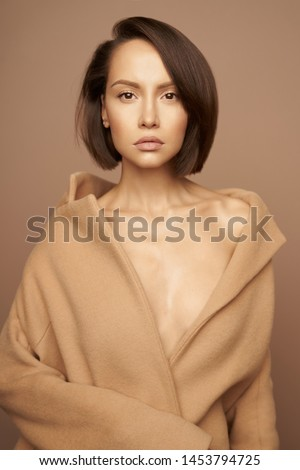 Fashion studio photo of young beautiful lady in beige coat on beige background. Total beige. Fashion look book. Warm Autumn. Warm Spring #1453794725