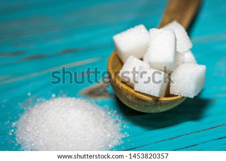 White sugar refined and crystallized on a blue background. #1453820357