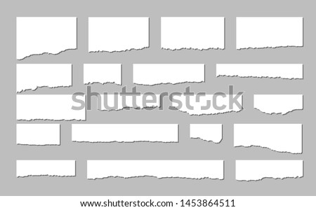 Torn sheets of paper. A set of torn paper and strips of paper on a dark background. Vector illustration. #1453864511
