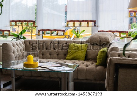 Cozy home interior in hygge style with comfortable sofa, plants and candles. #1453867193