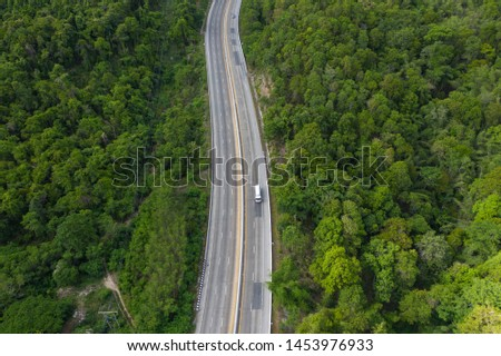 Road between forest and mountain,High angle drone view #1453976933