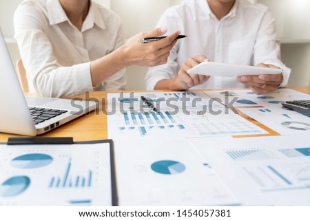 Business People Meeting to analyse and discuss and brainstorming the financial report chart data in office, Financial advisor teamwork and accounting concept #1454057381