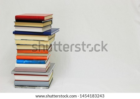 Stack of books on white background #1454183243
