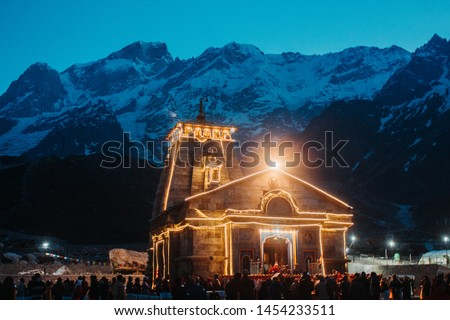 View of the Kedarnath temple lights at night with mountains in the background in Uttarakhand, India #1454233511