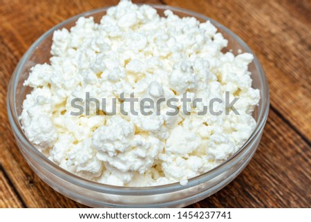 farm cottage cheese close up on wooden background protein healthy diet eco product #1454237741