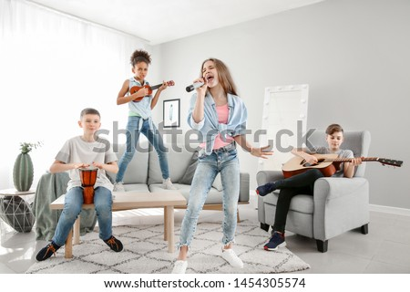 Teenage musicians playing and singing at home #1454305574