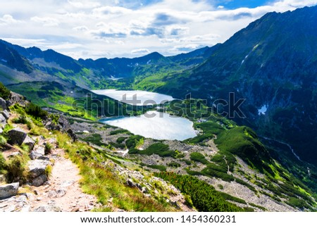 Five Ponds Valley. The High Tatras Mountains (Vysoké Tatry, Tatry Wysokie, Magas-Tátra), are a mountain range along the border of Slovakia and southern Poland in the Lesser Poland Voivodeship.  #1454360231