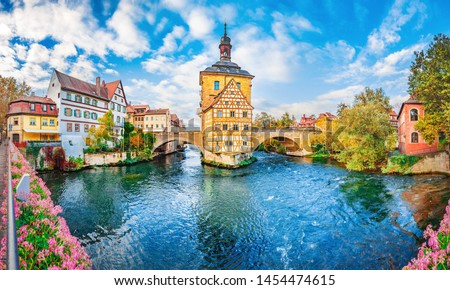 Old town Bamberg in Bavaria, Germany. Romantic  historical town on Romantic road in Bavaria,  located on crossing of Regnitz and Main rivers. Autumn view of old Timber Framing architecture and flowers #1454474615