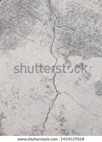 Crack in concrete. Cracked foundation. Cracked road. #1454529068