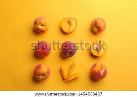 Flat lay composition with fresh peaches on yellow background #1454538437