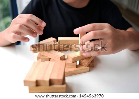 wooden block Planning, risk and strategy of project management in business, with hand pull wood block #1454563970
