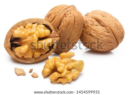 Delicious whole and broken walnuts, isolated on white background #1454599931