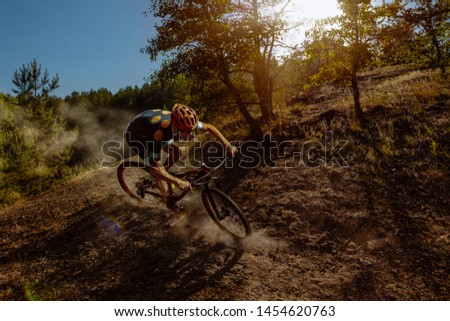 Cyclist in action on a beautiful location #1454620763