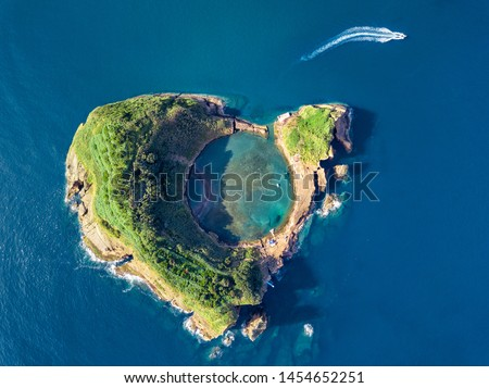 Azores aerial panoramic view. Top view of Islet of Vila Franca do Campo. Crater of an old underwater volcano. San Miguel island, Azores, Portugal. Heart carved by nature. Bird eye view. #1454652251
