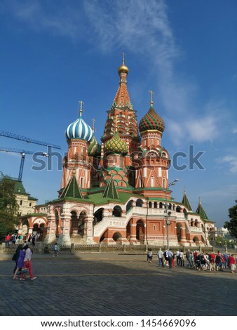Moscow, Russia. June 17, 2019. Many tourists are walking back in the afternoon. They passed St. Basil's Cathedral, the most famous church in Russia.  #1454669096