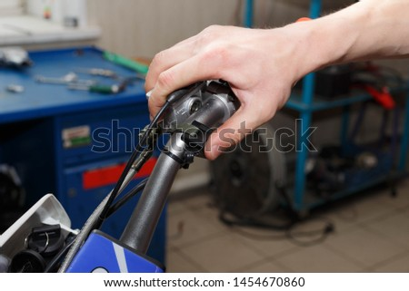 Hand pressing the off-run button on a motorcycle. Start the motorcycle engine. #1454670860