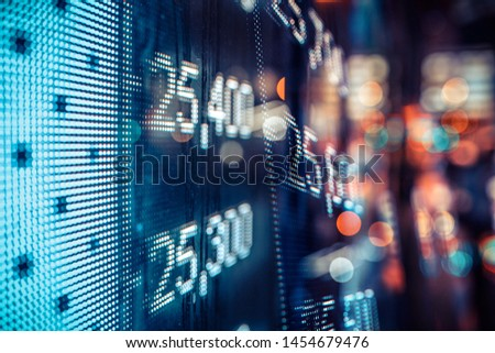 Display of Stock market quotes with city lights reflect on glass #1454679476