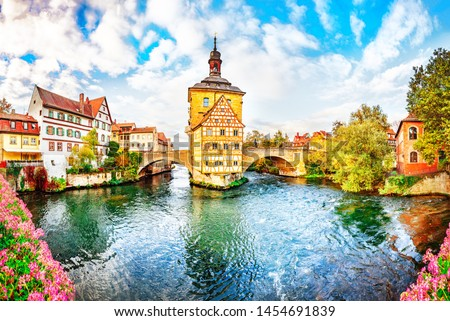 Old town Bamberg in Bavaria, Germany. Romantic  historical town on Romantic road in Bavaria,  located on crossing of Regnitz and Main rivers. Autumn view of old Timber Framing architecture and flowers #1454691839