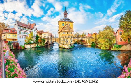 Old town Bamberg in Bavaria, Germany. Romantic  historical town on Romantic road in Bavaria,  located on crossing of Regnitz and Main rivers. Autumn view of old Timber Framing architecture and flowers #1454691842