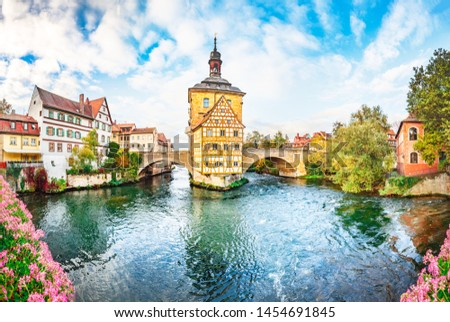 Old town Bamberg in Bavaria, Germany. Romantic  historical town on Romantic road in Bavaria,  located on crossing of Regnitz and Main rivers. Autumn view of old Timber Framing architecture and flowers #1454691845
