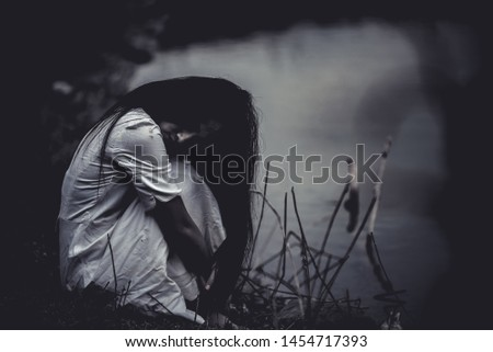 Portrait of asian woman make up ghost face at the swamp,Horror scene,Scary background,Halloween poster,Thailand people #1454717393