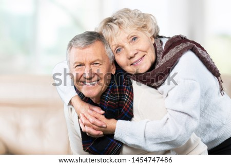 Portrait of happy senior couple smiling at home #1454747486