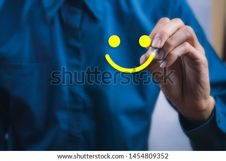 Conceptual the customer responded to the survey. The client using digital pen write happy face smile icon. Depicts that customer is very satisfied. Service experience and satisfaction concept. #1454809352