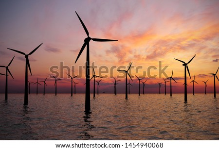 Offshore Wind Turbines Farm At sunset #1454940068