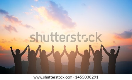 Silhouette of happy business team making high hands in city background for business teamwork concept #1455038291