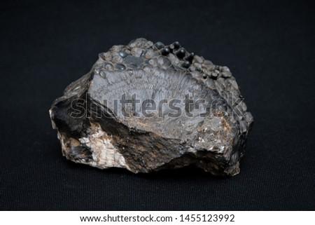 Stalagmite on black gemstone gem jewel mineral precious stone caption #1455123992